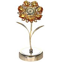 Фигурка декоративная Ромашка, с часами. 6724567245Декоративная фигурка выполнена в виде цветка с часами в центре, оформленного кристаллами Swarovski. Фигурка будет вас радовать и достойно украсит интерьер вашего дома или офиса. Вы можете поставить украшение в любом месте, где оно будет удачно смотреться и радовать глаз. Кроме того, эта фигурка - отличный вариант подарка для ваших близких и друзей. Характеристики: Материал: углеродная сталь, австрийские кристаллы. Размер фигурки: 13 см х 6,5 см х 5,5 см. Размер упаковки: 14 см х 10,5 см х 7,5 см. Производитель: Китай. Артикул: 67245. Более чем 30 лет назад компания Crystocraft выросла из ведущего производителя в перспективную торговую марку, которая задает тенденцию благодаря безупречному чувству красоты и стиля. Компания создает изящные, качественные, яркие сувениры, декорированные кристаллами Swarovski различных размеров и оттенков, сочетающие в себе превосходное мастерство обработки металлов и самое высокое качество...