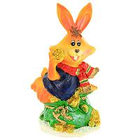 Декоративная фигурка Заяц с монетами. 2051420514Декоративная фигурка, выполненная в виде зайца, сидящего на мешке с золотыми монетами, будет вас радовать и достойно украсит интерьер. Фигурка украшена блестками. Вы можете поставить фигурку в любом месте, где она будет удачно смотреться и радовать глаз.