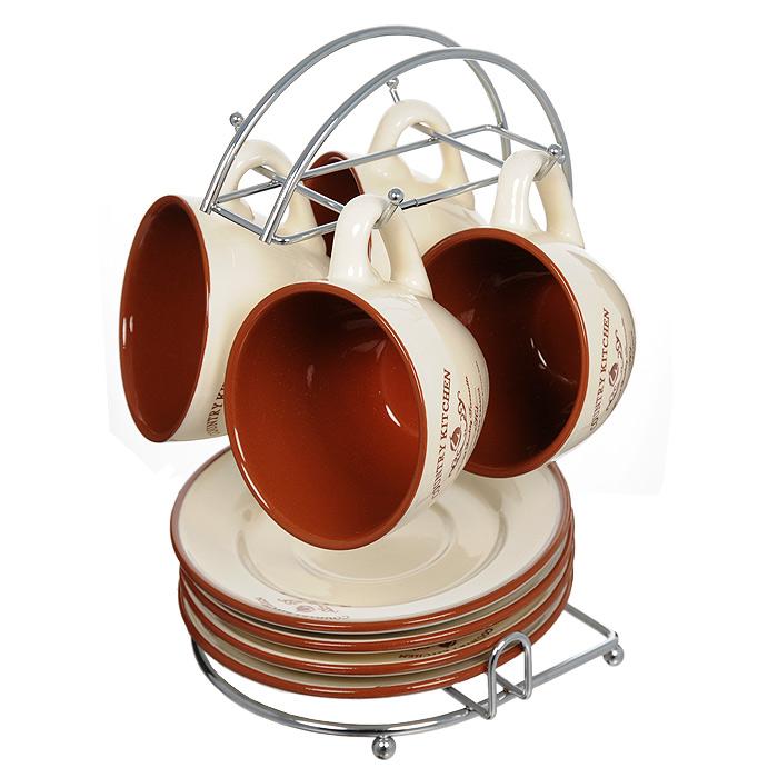 Набор чайный Terracotta Кухня в стиле Кантри 9 предметов TLY314-CK-ALTLY314-CK-ALЧайный набор Кухня в стиле Кантри состоит из металлической подставки, 4 блюдец и 4 чашек. Предметы набора изготовлены из жаропрочной керамики и покрыты высококачественной глазурью. Такой чайный набор не оставит равнодушной не одну хозяйку или станет прекрасным подарком. Характеристики: Материал: металл, керамика. Диаметр блюдца: 15,7 см. Диаметр кружки по верхнему краю: 9 см. Диаметр основания кружки: 5 см. Высота кружки: 7 см. Объем кружки: 200 мл. Размер подставки (Д х Ш х В): 17 см х 16,5 см х 24,5 см. Размер упаковки: 17,5 см х 17 см х 25 см. Производитель: Италия. Изготовитель: Китай. Артикул: TLY314-CK-AL. Торговая марка Terracotta - это коллекции разнообразной посуды для сервировки стола, хранения продуктов и приготовления пищи из жаропрочной керамики, покрытой высококачественной глазурью. Изделия Terracotta идеально подходят для выпечки, приготовления различных блюд и разогревания пищи в духовом шкафу или...