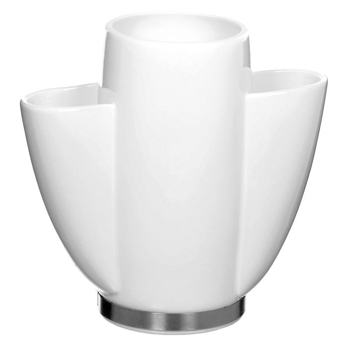 Подставка под кухонные инструменты Sara35130Элегантная подставка Sara используется для хранения кулинарных принадлежностей. Подставка выполнена из высококачественного фарфора. Характеристики: Материал: фарфор, сталь. Размеры подставки (Д х Ш х В): 21 см х 10 см х 20 см. Размер центральной секции: 8,5 см х 11 см. Размер боковых секций: 4,5 см х 6 см. Размер упаковки: 24 см х 23 см х 15,5 см. Производитель: Германия. Артикул: 35130. Уважаемые клиенты! Обращаем ваше внимание, что кухонные принадлежности изображенные на фотографии не входят в комплектацию товара, а служат лишь для демонстрации товара.