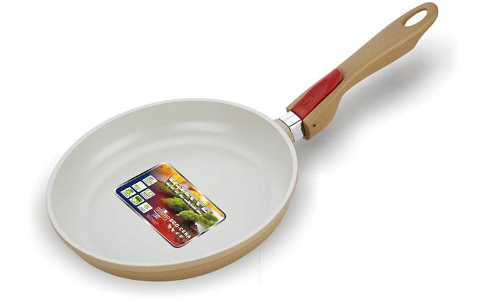 Сковорода Vitesse Frypan, со съемной ручкой. Диаметр 20 смVS-2250Сковорода Vitesse Frypan с антипригарным покрытием класса премиум и со съемной ручкой. Особенности сковороды: - изготовлена из высококачественного алюминия; - стойкое керамическое покрытие, позволяющее готовить при температуре до 450°C; - покрытие безопасное для здоровья человека, не содержит PFOA; - покрытие стойкое к царапинам, возможно использование металлической лопатки; - съемная ручка; - равномерное нагревание и доведение блюда до готовности. Сковорода Vitesse Frypan подходит для всех видов плит, кроме индукционных. Характеристики: Материал: алюминий, пластик. Внешний диаметр по верхнему краю: 21 см. Внутренний диаметр по верхнему краю: 20 см. Высота сковороды: 3,8 см. Длина ручки: 19,5 см. Размер упаковки: 22 см х 24 см х 4,5 см. Изготовитель: Китай. Артикул: VS-2250. Французская торговая марка Vitesse представляет высококачественную посуду из нержавеющей стали 18/10....