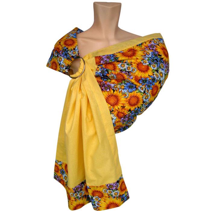 Слинг на кольцах Солнышко, цвет: желтый. Размер SSKU01-001Слинг на кольцах Солнышко изготовлен из бязи - натуральной хлопковой ткани, экологичной, дышащей и гипоаллергенной. В этой модели нет ничего лишнего - но вместе с тем продумана каждая мелочь: уплотненные бортики, мягкое плечо, яркая и радостная расцветка с подсолнухами. Слинг - очень удобное, простое и естественное приспособление для ношения ребенка. Преимущества слинга на кольцах состоят в том, что мама может привязать ребенка на живот, бедро или спину в абсолютно разных положениях. Ребенок теснее прижат к маме, его ножки не болтаются и, таким образом, его вес распределяется более равномерно. Слинг освобождает маме руки без потери близкого контакта с малышом, благодаря чему мама может заниматься домашними делами и вести активный образ жизни: ходить по магазинам, музеям, в гости. К тому же ношение ребенка в слинге помогает наладить грудное вскармливание, а расположение ребенка в позе лягушка является профилактикой дисплазии тазобедренных суставов. В комплекте со слингом...