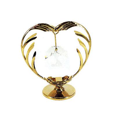 Миниатюра Сердце, цвет: золотистый, 7 см67114Миниатюра Сердце, золотистого цвета, станет необычным аксессуаром для вашего интерьера и создаст незабываемую атмосферу. Кристаллы, украшающие сувенир, носят громкое имя Swarovski - ограненные, как бриллианты, кристаллы блистают сотнями тысяч различных оттенков. Эта очаровательная вещь послужит отличным подарком близкому человеку, родственнику или другу, а также подарит приятные мгновения и окунет вас в лучшие воспоминания.
