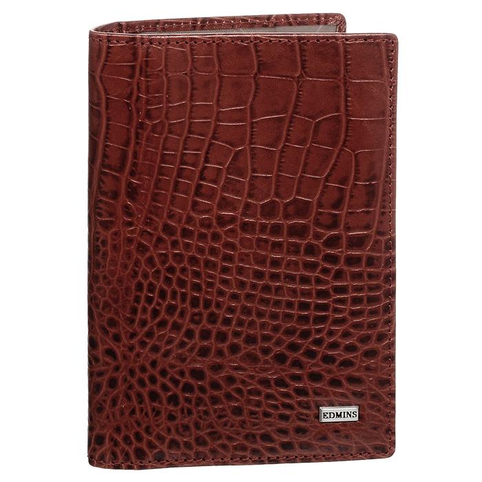 Обложка для автодокументов Edmins, цвет: красный. 1896 CR ML ED red64396Обложка для автодокументов Edmins выполнена из натуральной кожи красного цвета и оформлена декоративныи тиснением под крокодила. Имеет внутри: два глубоких вертикальных кармана, один из которых из прозрачного пластика, кармашек с окошком, карман-уголок для мелких бумаг, а также внутренний блок для водительских документов из прозрачного пластика. Такая обложка станет отличным подарком для человека, ценящего качественные и необычные вещи.