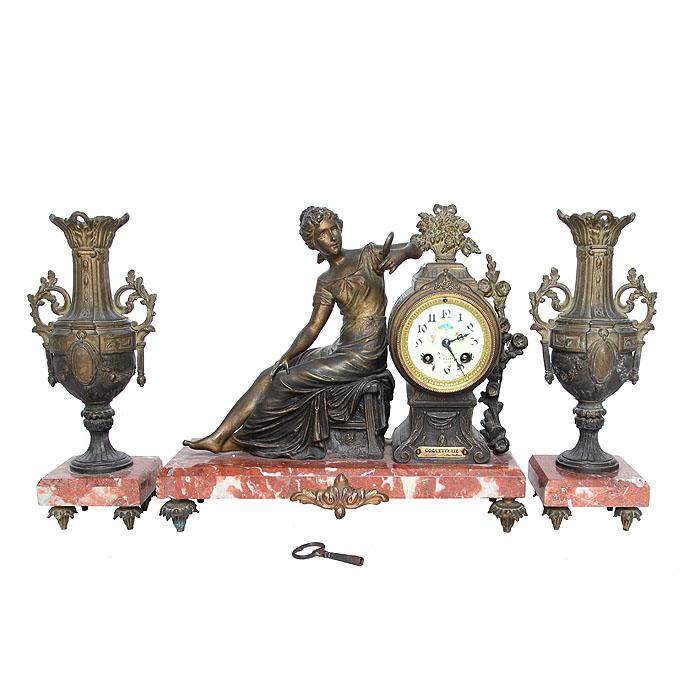 Часы и касолеты Кокетка. Бронза, роспись, латунь, мрамор, эмаль. Франция, около 1880-го годаПБ ДПА 16082016-8Идеально для роскошного представительского подарка высокопоставленному лицу! Часы и касолеты Кокетка. Бронза, роспись, латунь, мрамор, эмаль. Франция, около 1880-го года. Размеры часов: высота 34 см, длина 38 см, глубина 15 см. Диаметр циферблата 8 см. Касолеты: высота 34 см, размер основания 11 х 11 см. Сохранность очень хорошая. Незначительный дефект литья на одной из касолет. На механизме клеймо Societe Clusienne S.C.A.P.H. Cluses и индивидуальный номер 23821. Под часами шильда COQUETTERIE par Ruffony (КОКЕТКА скульптора Руффони). На циферблате надписи на французском языке (неразборчиво, частично стерты). Оригинальные маятник и ключ - в комплекте. Часы приятно бьют каждые полчаса и каждый час. Композиция создана скульптором О. Руффони (O. Ruffony) - известным итальянским мастером конца XIX-го-начала XX вв. Роскошные часы украшены фигурным изображением юной девушки, которая,...