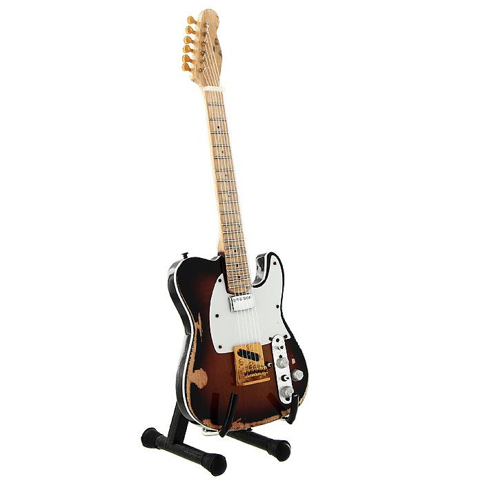 Коллекционная модель гитары Энди Саммерса Fender Tribute Telecaster. Масштаб 1:41020574Модель электрогитары Fender Tribute Telecaster английского гитариста и композитора Энди Саммерса, участника группы The Police, представляет собой точную копию инструмента, выполненную в уменьшенном масштабе. Такой сувенир понравится не только поклоннику знаменитой группы, но и человеку, ценящему оригинальные вещи. Коллекционная модель станет оригинальным украшением интерьера. Благодаря специальной подставке вы можете поставить модель гитары в любом месте, где она будет удачно смотреться.