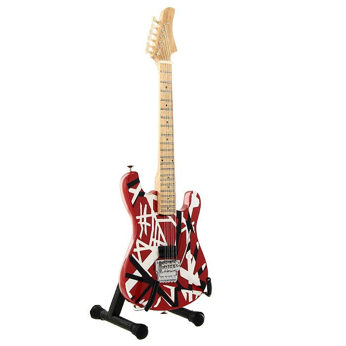 Коллекционная модель гитары Эдди Ван Халена Kramer Baretta. Масштаб 1:41020833Модель электрогитары Kramer Baretta гитариста американской хард-рок группы Van Halen, представляет собой точную копию инструмента, выполненную в уменьшенном масштабе. Такой сувенир понравится не только поклоннику знаменитой рок-группы, но и человеку, ценящему оригинальные вещи. Коллекционная модель станет оригинальным украшением интерьера. Благодаря специальной подставке вы можете поставить модель гитары в любом месте, где она будет удачно смотреться.