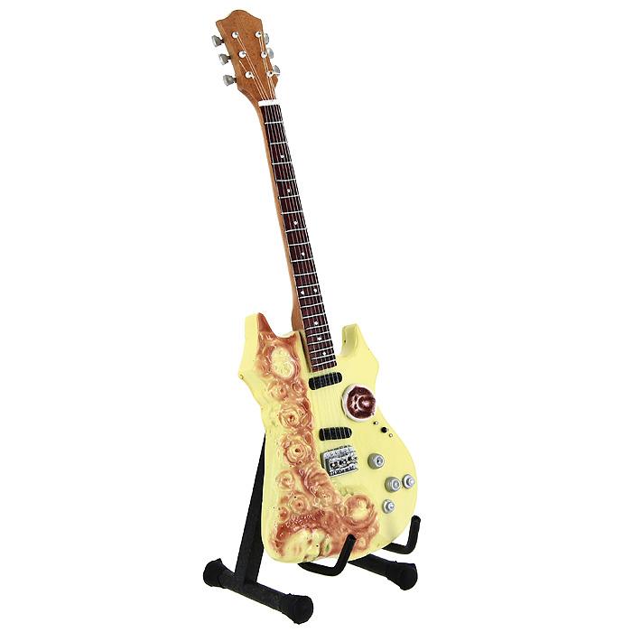 Коллекционная модель гитары Джерри Гарсия Grateful Dead Tribute. Масштаб 1:41020192Модель электрогитары Grateful Dead Tribute знаменитого американского рок-музыканта Джерри Гарсия, представляет собой точную копию инструмента, выполненную в уменьшенном масштабе. Такой сувенир понравится не только поклоннику известного рок-музыканта, но и человеку, ценящему оригинальные вещи. Коллекционная модель станет оригинальным украшением интерьера. Благодаря специальной подставке вы можете поставить модель гитары в любом месте, где она будет удачно смотреться. Одним из многочисленных ценителей данной модели является Джерри Гарсия.