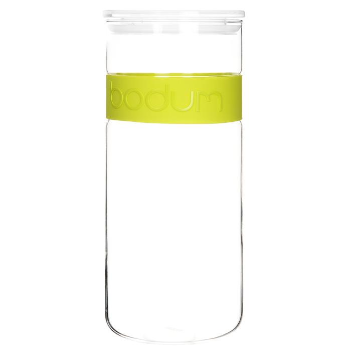 Банка для хранения Presso, цвет: салатовый, 2,5 л11131-Банка для хранения Presso, выполненная из прозрачного стекла, станет незаменимым помощником на кухне. В верхней части банки имеется вставка из приятного на ощупь силикона салатового цвета. В такой банке будет удобно хранить разнообразные сыпучие продукты, такие как кофе, крупы, макароны или специи. Емкость легко и герметично закрывается пластиковой крышкой с уплотнителем. Такая банка не только сэкономит место на вашей кухне, но и украсит интерьер. Оригинальный дизайн позволит сделать такую банку отличным подарком на любой праздник. Можно мыть в посудомоечной машине. Характеристики: Цвет: салатовый. Материал: стекло, силикон, пластик. Объем банки: 2,5 л. Диаметр банки: 12 см. Высота банки: 28 см. Размер упаковки: 29 см х 12,5 см х 12,5 см. Производитель: Швейцария. Артикул: 11131-.