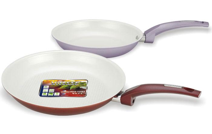 Набор сковородок Vitesse, 2 шт, диаметр 24 см, 28 смVS-2220Набор сковородок Vitesse состоит из двух сковородок разного диаметра. Изготовленные из высококачественного алюминия, они являются лучшими помощниками в кулинарном искусстве! Внутреннее антипригарное керамическое покрытие премиум класса обеспечивает высокое качество приготовления пищи. Бакелитовые, высокопрочные, не нагревающиеся, огнестойкие ручки очень удобны. Специальное строение дна обеспечивает быстрый нагрев и равномерное распределение тепла по всей поверхности. Простые в уходе и стойкие к царапинам, сковородки имеют элегантное цветовое покрытие, подвергшееся высокотемпературной обработке. Набор сковородок Vitesse не подходит для использования на индукционной плите.