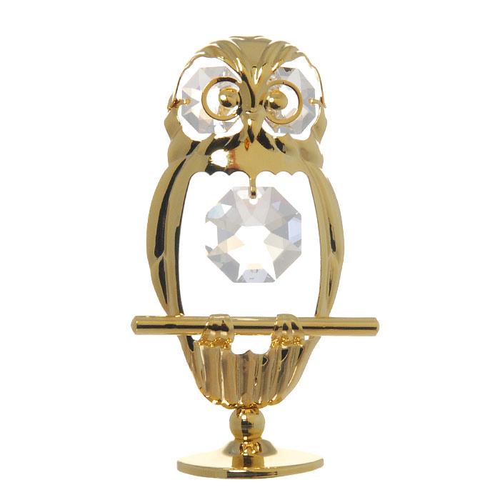 Миниатюра Пятнистая сова, цвет: золотистый, 8 смU0120-001-GC1Декоративное изделие в виде совы украшенной бесцветными кристаллами Swarovski, изготовлено из высококачественной стали. Оригинальная миниатюра будет отличным подарком для ваших друзей и коллег. Более 30 лет компания Crystocraft создает качественные, красивые и изящные сувениры, декорированные различными кристаллами Swarovski. Характеристики: Материал: сталь, кристаллы Swarovski. Высота: 7 см. Размер коробки: 6,5 см х 9 см х 4,5 см. Артикул: U0120-001-GC1. Производитель: Китай.
