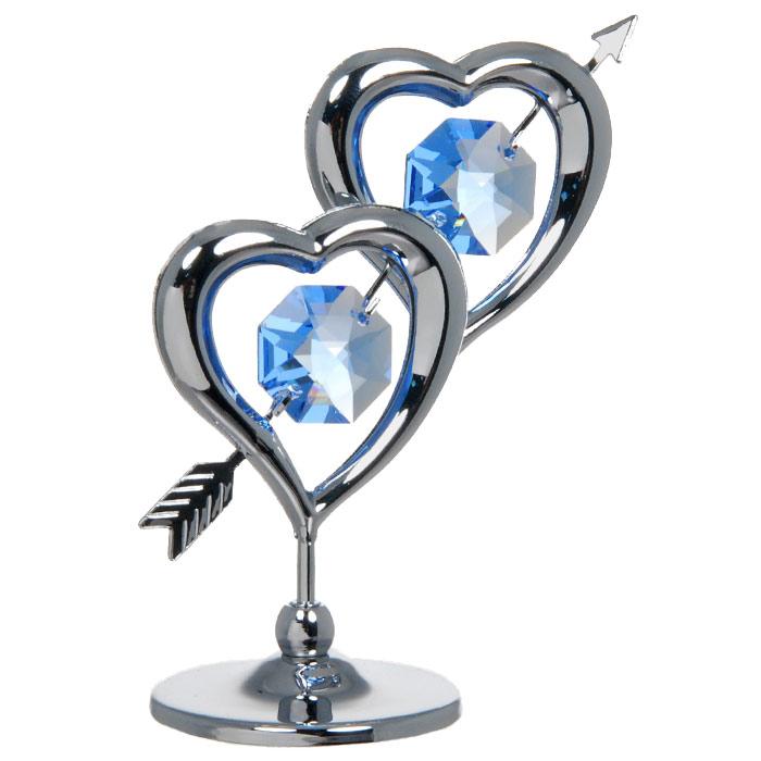 Миниатюра Два сердца пронзенные стрелой, цвет: серебристый, 6,5 смU0236-001-CBLДекоративное изделие в виде двух сердец пронзенных одной стрелой, украшенных посередине голубыми кристаллами Swarovski, изготовлено из высококачественной стали. Оригинальная миниатюра будет отличным подарком для ваших друзей и коллег. Более 30 лет компания Crystocraft создает качественные, красивые и изящные сувениры, декорированные различными кристаллами Swarovski. Характеристики: Материал: сталь, кристаллы Swarovski. Высота: 6,5 см. Размер коробки: 7 см х 9 см х 4,5 см. Артикул: U0236-001-CBL. Производитель: Китай.