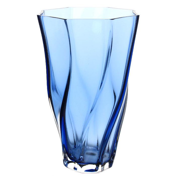 Ваза Fiamma, 30 см13046Элегантная ваза Fiamma послужит отличным дополнением к интерьеру вашего дома. Ваза изготовлена из прозрачного синего стекла. Эксклюзивная ваза подчеркнет оригинальность интерьера и прекрасный вкус хозяина. Создайте в своем доме атмосферу уюта, преображая интерьер стильными, радующими глаза предметами. Также ваза может стать хорошим подарком вашим друзьям и близким. Характеристики: Материал: стекло. Высота вазы: 30 см. Диаметр: 20 см. Размер упаковки: 20,5 см х 33 см х 20,5 см. Производитель: Турция. Артикул: 13046.