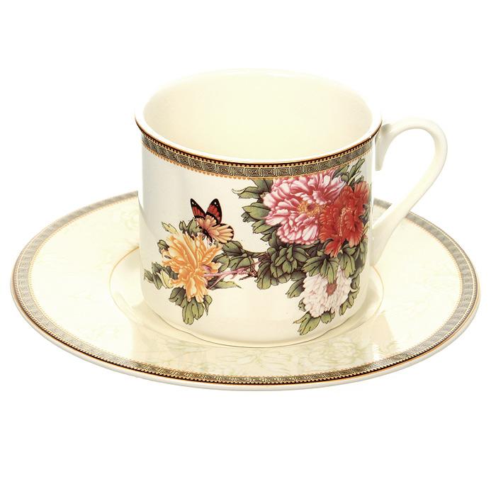 Чайная пара Японский сад, 200 млIM15018E-1730ALЧайная пара Японский сад выполнена из высококачественной керамики и покрыта сверкающей глазурью, не содержащей свинца. Чайная пара состоит из чашки и блюдца. Чашка белого цвета с цветочным рисунком и рисунком-окантовкой по краю, повторяющимся и на блюдце. Блюдце нежного светло-бежевого цвета с цветочным рисунком и рисунком-окантовкой по краю.
