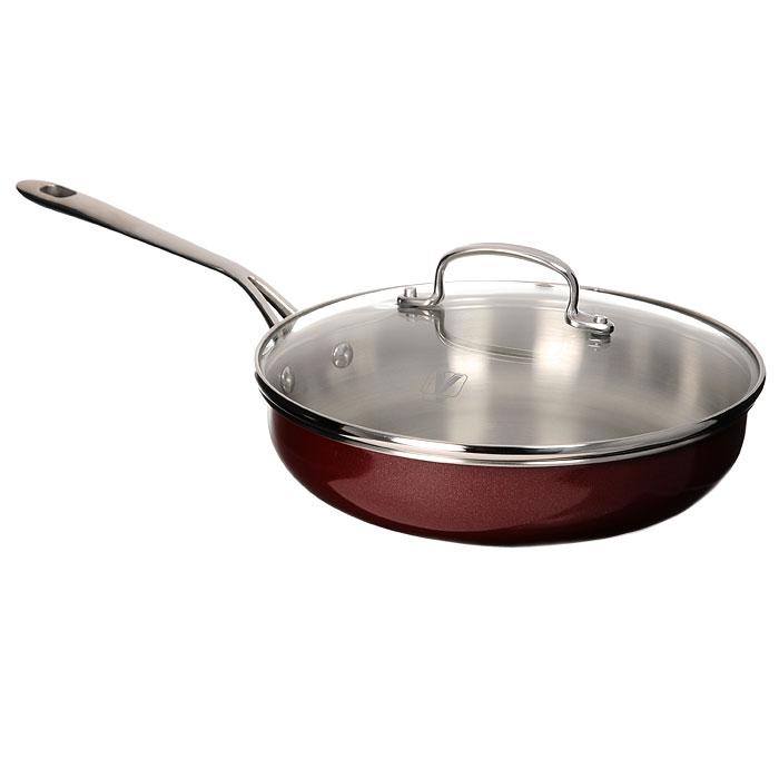 Сковорода Vitesse Dahlia, цвет: бордовый. Диаметр 24,5 смVS-1489Сковорода Vitesse Dahlia, изготовленная из высококачественной нержавеющей стали 18/10, предоставит вам все необходимое для получения удовольствия от приготовления пищи и принесет радость от его результатов. Многослойное термоаккумулирующее дно сковороды с прослойкой из алюминия обеспечивает наилучшее распределение тепла. Прозрачная крышка, выполненная из термостойкого стекла с клапаном для выпуска пара, позволяет следить за процессом приготовления пищи, а литые ручки, крепящиеся заклепками, обеспечивают удобство при эксплуатации. Форма кромки сковороды предотвращает разливание жидкости, а благодаря правильности линий кромки в комбинации с крышкой обеспечивается максимальная герметизация между ними. Наружная поверхность сковороды отделана бордовым полиэстеровым покрытием, что придает ей нотки благородности и изысканности. Сковорода подходит для всех типов плит, кроме индукционных, можно использовать в духовке и мыть в посудомоечной машине. Характеристики: ...