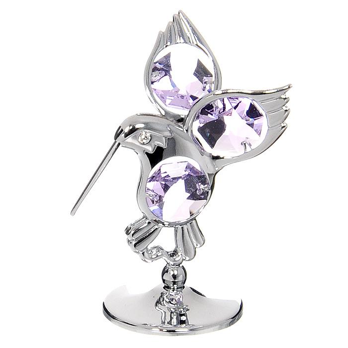Миниатюра Колибри, цвет: серебристый, 6 смU0007-001-CVLМиниатюра Колибри серебристого цвета станет необычным аксессуаром для вашего интерьера и создаст незабываемую атмосферу. Кристаллы, украшающие сувенир, носят громкое имя Swarovski. Ограненные, как бриллианты, кристаллы блистают сотнями тысяч различных оттенков. Эта очаровательная вещь послужит отличным подарком близкому человеку, родственнику или другу, а также подарит приятные мгновения и окунет вас в лучшие воспоминания.