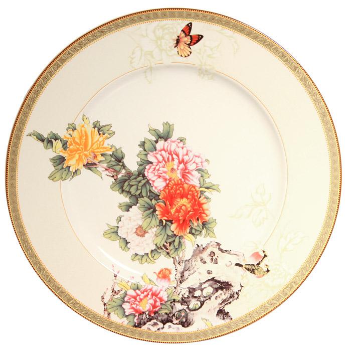 Тарелка Японский сад, диаметр 23 смIM35031-1730ALКерамическая тарелка Японский сад сочетает в себе изысканный дизайн с максимальной функциональностью. Тарелка оформлена оригинальным цветочным рисунком на светло-бежевом фоне. Красочность оформления придется по вкусу и ценителям классики, и тем, кто предпочитает утонченность и изысканность. Тарелка Японский сад украсит сервировку вашего стола и подчеркнет прекрасный вкус хозяина, а также станет отличным подарком. Характеристики: Материал: керамика. Диаметр: 23 см. Размер упаковки: 23,5 см х 23,5 см х 3 см. Производитель: Китай. Артикул: IM35031-1730AL. Изделия торговой марки Imari произведены из высококачественной керамики, основным ингредиентом которой является твердый доломит, поэтому все керамические изделия Imari - легкие, белоснежные, прочные и устойчивы к высоким температурам. Высокое качество изделий достигается не только благодаря использованию особого сырья и новейших...