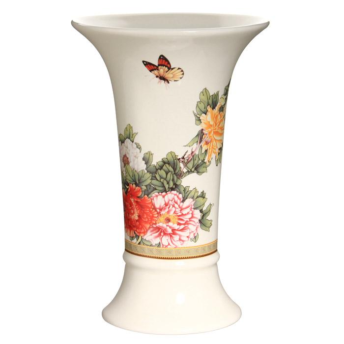 Ваза для цветов Японский сад, высота 21,5 смIM65078-1730ALВаза для цветов Японский сад, выполненная из высококачественной керамики белого цвета, станет отличным дополнением к интерьеру вашего дома. Ваза имеет оригинальную форму и украшена красочным рисунком с изображением цветов. Элегантная ваза станет не просто сосудом для цветов, но и оригинальным сувениром, который радует глаз и создает настроение. Окружая себя красивыми вещами, вы создаете в своем доме атмосферу гармонии, тепла и комфорта. Характеристики: Материал: керамика. Высота вазы: 21,5 см. Диаметр вазы по верхнему краю: 14 см. Диаметр основания вазы: 10 см. Размер упаковки: 13,5 см х 22 см х 14 см. Производитель: Китай. Артикул: IMF65078-1730AL. Изделия торговой марки Imari произведены из высококачественной керамики, основным ингредиентом которой является твердый доломит, поэтому все керамические изделия Imari - легкие, белоснежные, прочные и устойчивы к высоким температурам. Высокое качество изделий...