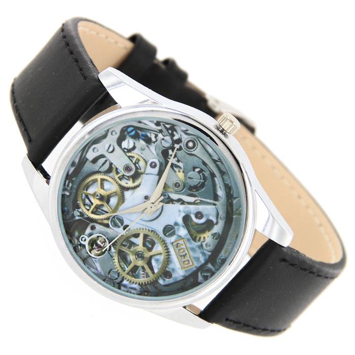 Часы Mitya Veselkov Часовой механизм.MV-26MV-026Наручные часы Mitya Veselkov Часовой механизм созданы для современных людей, которые стремятся выделиться из толпы и подчеркнуть свою индивидуальность. Часы оснащены японским кварцевым механизмом. Ремешок выполнен из натуральной кожи черного цвета, корпус изготовлен из стали серебристого цвета. Циферблат оформлен изображением часового механизма.