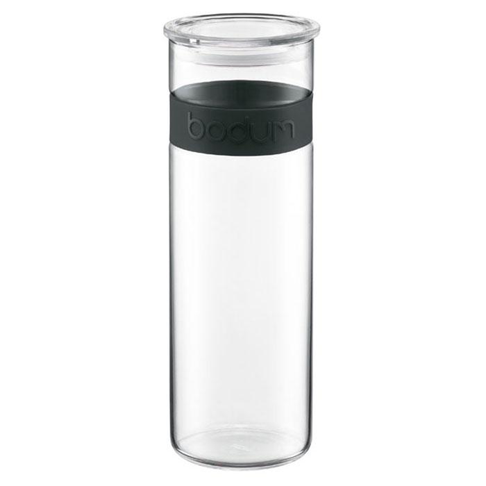 Банка для хранения Presso, цвет: черный, 1,9 л11132-01Банка для хранения Bodum Presso, выполненная из прозрачного боросиликатного стекла, станет незаменимым помощником на кухне. В такой банке будет удобно хранить разнообразные сыпучие продукты, такие как кофе, крупы, макароны или специи. Она не впитывает запахов продуктов и очень удобна в использовании. В верхней части банки имеется вставка из приятного на ощупь силикона. Емкость легко и герметично закрывается пластиковой крышкой с уплотнителем. Боросиликатное стекло и силикон выдерживают нагрев до очень высоких температур и приспособлены для мытья в посудомоечной машине. Банка для хранения Bodum Presso не только сэкономит место на вашей кухне, но и украсит интерьер. Оригинальный дизайн позволит сделать такую банку отличным подарком на любой праздник. Характеристики: Материал: стекло, пластик. Объем банки: 1,9 л. Диаметр банки: 9,5 см. Высота банки (без учета крышки): 28 см. Цвет вставки: черный. Размер упаковки: 11 см х 29,5 см х...