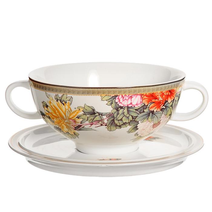 Суповая чашка Японский сад на блюдцеIMB0304-1730ALСуповая чашка Японский сад, изготовленная из керамики, предназначена для порционной подачи супов, бульонов, гуляшей и прочих первых блюд. В комплект с чашкой входит блюдце-подставка. Чашка и блюдце оформлены красочным рисунком с изображением цветов. Суповая чашка Японский сад украсит ваш обеденный стол и привнесет в интерьер уют. Чашка для супа также может стать великолепным подарком для родственников или друзей. Керамическая чашка идеально подходит для приготовления различных блюд и разогревания пищи в духовом шкафу или микроволновой печи. Характеристики: Материал: керамика. Диаметр чашки по верхнему краю: 14 см. Высота чашки: 6,5 см. Объем чашки: 0,5 л. Диаметр блюдца: 18 см. Размер упаковки: 18,5 см х 9 см х 18,5 см. Производитель: Китай. Артикул: IMB0304-1730AL. Изделия торговой марки Imari произведены из высококачественной керамики, основным...