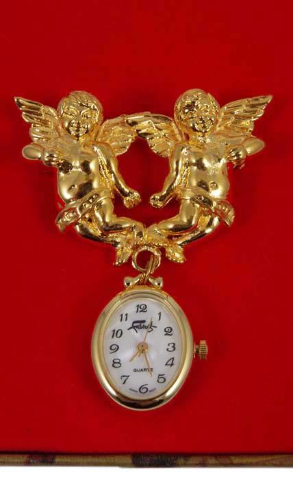 Часы-брошь Ангелочки. Металл, позолота, японский часовой механизм. Фаберже, 1990-е гг.BR0013Часы-брошь Ангелочки. Металл, позолота, японский часовой механизм. Фаберже, 1990-е гг. Диаметр часов: 2 см. Размер броши: 5 х 3 см. Сохранность очень хорошая. На оборотной стороне - клейма Faberge Stainless Steel Back. Стильные и неповторимые часы Фаберже - это роскошный и оригинальный подарок для самой прекрасной!