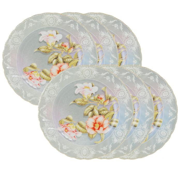 Набор десертных тарелок Нюанс, 6 шт4601137104096Набор Нюанс состоит из шести десертных тарелок, выполненных из высококачественного фарфора. Тарелки оформлены красочным рисунком, на котором изображены цветы, а по краю декорированы оригинальным узором и золотистой каймой. Они сочетают в себе изысканный дизайн с максимальной функциональностью. Оригинальность оформления придется по вкусу и ценителям классики, и тем, кто предпочитает утонченность и изящность. Набор тарелок Нюанс станет украшением сервировки вашего стола, а также послужит замечательным подарком к любому празднику. Тарелки упакованы в стильную подарочную коробку из плотного картона нежного розового цвета. Характеристики: Материал: фарфор. Диаметр тарелки: 19,5 см. Комплектация: 6 шт. Размер упаковки: 20,5 см х 8,5 см х 20,5 см. Производитель: Китай. Артикул: 111126.