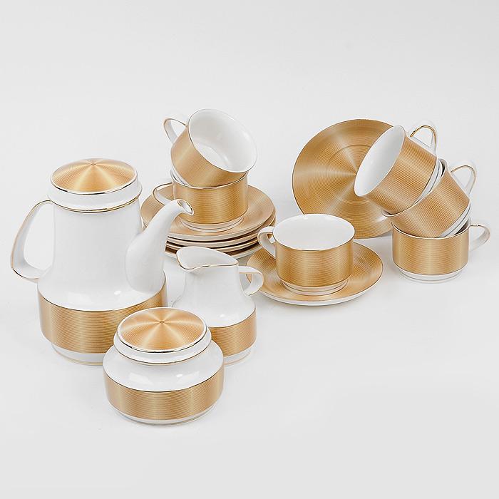Чайный сервиз Сахара Голд, 15 предметов4601137092829Чайный сервиз Сахара Голд станет украшением сервировки вашего стола, а также послужит замечательным подарком к любому празднику. Он состоит из шести чашек, шести блюдец, заварочного чайника, сахарницы и молочника. Предметы набора изготовлены из высококачественного фарфора и имеют оригинальное оформление. Такой чайный сервиз настроит на позитивный лад и подарит хорошее настроение. Красочный дизайн придется по вкусу и ценителям классики, и тем, кто предпочитает утонченность и изысканность. Чайный сервиз упакован в стильную подарочную коробку из плотного картона. Внутренняя часть коробки задрапирована белым атласом, и каждый предмет надежно крепится в определенном положении благодаря особым выемкам.