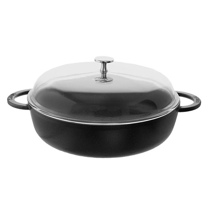 Сотейник чугунный Staub Соты с крышкой 3,7л, цвет: черный 12729561272956Сотейник Staub Соты изготовлен из чугуна, покрытого эмалью снаружи и внутри. Высокая теплоемкость чугуна позволяет ему сильно нагреваться и медленно остывать, а это в свою очередь обеспечивает равномерное приготовление пищи. Известно, что пища, приготовленная в чугунной посуде, сохраняет свои вкусовые качества, и благодаря экологической чистоте материала, не может нанести вред здоровью человека. Внутреннее дно сотейника выполнено в виде сот по технологии Nidabeille. Сотейник снабжен двумя удобными короткими ручками. К сотейнику прилагается крышка, изготовленная из высококачественного стекла. Она оснащена удобной металлической ручкой. Крышка плотно прилегает к краю посуды, сохраняя аромат блюд. Сотейник подходит для использования на всех типах плит и в духовке. Изделие можно мыть в посудомоечной машине. Характеристики: Материал: чугун, металл, стекло. Объем сотейника: 3,7 л. Внутренний диаметр сотейника: 28 см. Высота стенки сотейника (без учета...