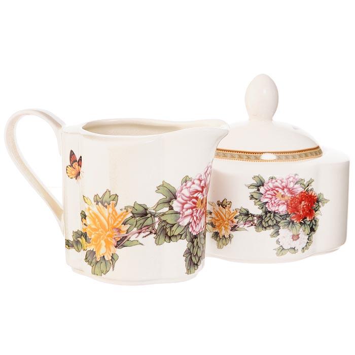 Набор Японский сад: сахарница, молочникIM15018B/C-1730ALНабор Японский сад, выполненный из высококачественной керамики, состоит из сахарницы с крышкой и молочника. Предметы набора декорированы оригинальным изображением. Они прекрасно подойдут для вашей кухни и великолепно украсят стол. Изящный дизайн и красочность оформления набора Японский сад придутся по вкусу и ценителям классики, и тем, кто предпочитает утонченность и изысканность. Характеристики: Материал: керамика. Размер сахарницы (с учетом крышки): 11 см х 9 см х 11 см. Объем сахарницы: 300 мл. Размер молочника: 13,5 см х 7 см х 9 см. Объем молочника: 250 мл. Размер упаковки: 10 см х 18,5 см х 10,5 см. Производитель: Китай. Артикул: IM15018B/C-1730AL. Изделия торговой марки Imari произведены из высококачественной керамики, основным ингредиентом которой является твердый доломит, поэтому все керамические изделия Imari - легкие, белоснежные, прочные и устойчивы к высоким...