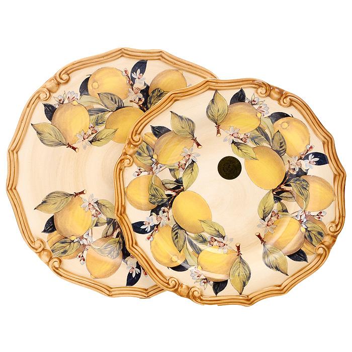 Набор тарелок Итальянские лимоны, 2 штLCS053-CL-ALНабор керамических тарелок Итальянские лимоны состоит из суповой и обеденной тарелок. Края тарелок украшены выпуклой декоративной окантовкой. Тарелки оформлены узором, изображающим лимоны на бежевом фоне. Характеристики: Материал: керамика. Диаметр суповой тарелки: 23,5 см. Высота суповой тарелки: 4 см. Диаметр обеденной тарелки: 25 см. Высота обеденной тарелки: 3 см. Размер упаковки: 27 см х 27 см х 7,5 см. Производитель: Италия. Артикул: LCS053-CL-AL.