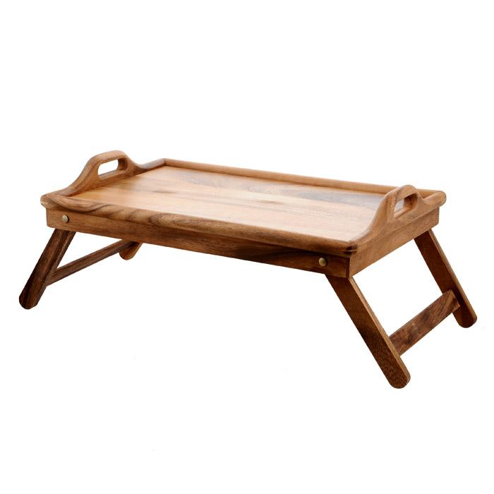 Столик-поднос Oriental way, 9/6299/629Столик-поднос Oriental way, выполненный из высококачественной древесины акации, практичен и прослужит вам долгие годы. Столик имеет складные ножки, поэтому может использоваться как поднос. Он покрыт пищевым лаком, который препятствует впитыванию влаги в изделие, тем самым продлевает срок его службы. Благодаря двум ручкам вы сможете с легкостью переносить стол, а удобные ножки надежно удержат его на любой поверхности. С этим столиком ваш утренний завтрак станет незабываемым! Особенности столика-подноса Oriental Way: - сделан из природного материала; - гармонирует с любым интерьером; - долгий срок службы; - не впитывает влагу; - не впитывает запахи; - нельзя мыть в посудомоечной машине.