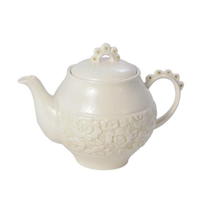 Чайник заварочный Georgia0721864Заварочный чайник Georgia, выполненный из керамики, сочетает в себе изысканный дизайн с максимальной функциональностью. Красочность оформления придется по вкусу и ценителям классики, и тем, кто предпочитает утонченность и изысканность. Характеристики: Материал: керамика. Высота чайника (без крышки): 11 см. Диаметр чайника (без носика и ручки): 12 см. Размер упаковки: 16 см х 13 см х 12,5 см. Артикул: 0721864.