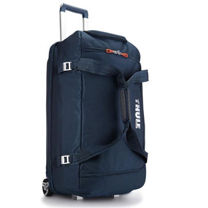 Сумка для багажа Thule, цвет: синий, 87 лTH_TR_TCRD-2DBСумка для багажа Thule выполнена из нейлона синего цвета. Сумка очень вместительная, подойдет для любой поездки. Особенности: Вместительная сумка с широко открывающейся застежкой-молнией для легкой укладки шлема, обуви, перчаток, куртки и других необходимых в путешествии вещей. Легкий прочный корпус из водонепроницаемого материала и алюминиевой фурнитуры; Жесткая конструкция и задняя панель из формованного полипропилена для надежной защиты от тряски и ударов; Увеличенные колеса и телескопические ручки V-образной формы Thule V-Tubing гарантируют плавный равномерный ход и эксплуатацию сумки в течение многих лет; Регулируемые ремни сжатия размера сумки; Жесткая, устойчивая к ударам секция SafeZone, для защиты очков, портативной электроники и других хрупких предметов, которую при необходимости можно снять, увеличив полезный объем основного отделения; Разделенное на секции основное отделение позволяет хранить отдельно...