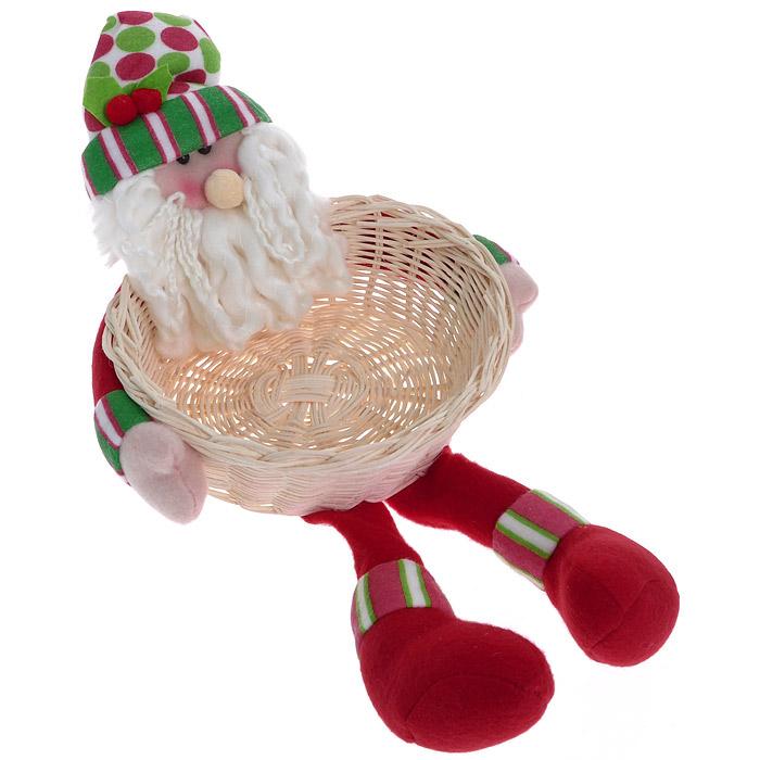 Новогоднее украшение Санта с корзиной. 2556425564Это симпатичный Санта с роскошной бородой может быть не только украшением, но и оригинальным оформлением подарка. Голова, руки и ноги выполнены из мягкого текстиля. В руках у него плетеная корзинка, куда с легкостью поместится несколько елочных украшений или небольшой презент.