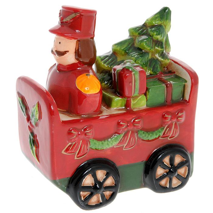 Новогодняя декоративная фигурка Вагончик с подарками. 2570325703Новогодняя декоративная фигурка Вагончик с подарками, изготовленная из керамики, украсит интерьер вашего дома или офиса в преддверии Нового года. Красный вагончик, украшенный рождественскими гирляндами, наполнен подарками и игрушками. Оригинальный дизайн и красочное исполнение создадут праздничное настроение. Новогодние украшения всегда несут в себе волшебство и красоту праздника. Создайте в своем доме атмосферу тепла, веселья и радости, украшая его всей семьей.