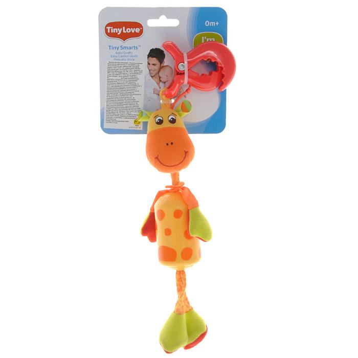 Игрушка-подвеска Tiny Love Жираф Самсон1109000458Яркая игрушка-подвеска Tiny Love Жираф Самсон, несомненно, придется по душе вашему малышу. Игрушка выполнена из пластика и текстильного материала различных фактур желтого, оранжевого и красного цветов. Внутри туловища игрушки, выполненного в виде пластикового цилиндра, расположен колокольчик, звенящий при тряске, а в ножках - шуршащий элемент. С помощью пластиковой клипсы игрушку легко можно прикрепить к детской кроватке, коляске или автомобильному креслу. Игрушка-подвеска Жираф Самсон поможет развить у малыша мелкую моторику рук, звуковое и зрительное восприятие, тактильные ощущения, координацию движений, а милый жизнерадостный образ подарит малышу хорошее настроение!