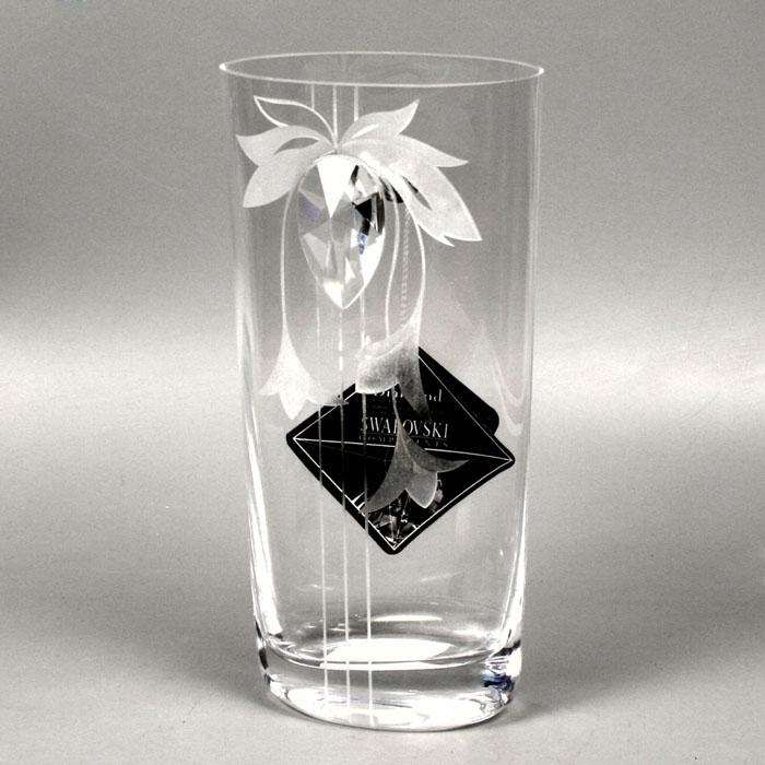 Вазон Deco-Glass, высота 22 см. АС 04116/0220/АА-Х1486АС 04116/0220/АА-Х1486Элегантный вазон Deco-Glass изготовлен из высококачественного прозрачного стекла. Вазон декорирован прозрачным кристаллом фирмы Swarovski и рельефным матовым узором. Эксклюзивный вазон подчеркнет оригинальность интерьера и прекрасный вкус хозяина. Создайте в своем доме атмосферу уюта, преображая интерьер стильными, радующими глаза предметами. Также вазон может стать хорошим подарком вашим друзьям и близким. Если вазон будет использоваться для цветочных композиций, то необходимо, чтобы вода находилась, по крайней мере, на 1 сантиметр ниже кристалла.