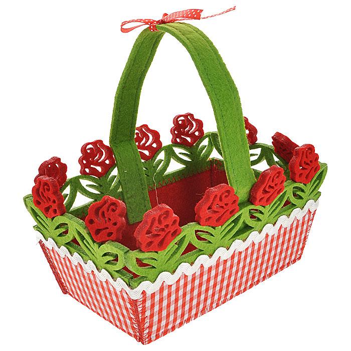 Декоративное украшение Корзинка. 2726727267Оригинальное декоративное украшение, выполненное из фетра в виде маленькой корзины. Корзинка декорирована отстрочкой, текстильной окантовкой по краю и перфорацией в виде красных цветов с листьями. Декоративное украшение послужит приятным и полезным сувениром для близких и знакомых и, несомненно, доставит массу положительных эмоций своему обладателю.