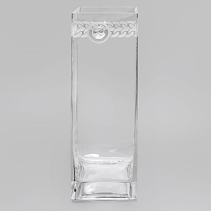 Вазон Deco-Glass, высота 30 см. АС 04118/0305/АА-Х1033АС 04118/0305/АА-Х1033Элегантный вазон Deco-Glass изготовлен из высококачественного прозрачного стекла. Вазон декорирован прозрачным кристаллом фирмы Swarovski и рельефным матовым узором по верху. Эксклюзивный вазон подчеркнет оригинальность интерьера и прекрасный вкус хозяина. Создайте в своем доме атмосферу уюта, преображая интерьер стильными, радующими глаза предметами. Также вазон может стать хорошим подарком вашим друзьям и близким. Если вазон будет использоваться для цветочных композиций, то необходимо, чтобы вода находилась, по крайней мере, на 1 сантиметр ниже кристалла.