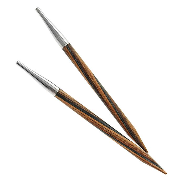 Спицы Prym деревянные съемные, № 6,5223329Деревянные спицы Prym комбинируются с леской различной длины. Кончики спиц закругленные. Круговые спицы предназначены для выполнения деталей и изделий, не имеющих швов. Так как вес изделия лучше распределяется именно на таких спицах, то ими очень удобно работать. Короткими круговыми спицами вяжут бейки горловины, воротники-гольф, длинными спицами можно вязать по кругу целые модели. Вы сможете вязать для себя, делать подарки друзьям. Рукоделие всегда считалось изысканным, благородным делом. Работа, сделанная своими руками, долго будет радовать вас и ваших близких.
