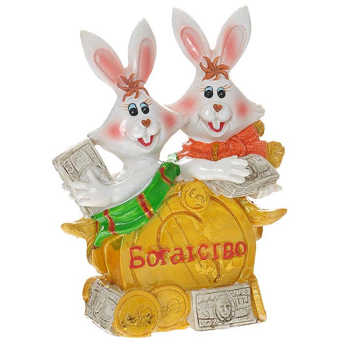 Копилка Богатство. 2051020510Копилка Богатство, выполненная в виде двух кроликов с банкнотами и золотыми монетами, станет оригинальным подарком и принесет вам и вашим близким отличное настроение и только положительные эмоции! Копилка - это оригинальный и функциональный сувенир для каждого.