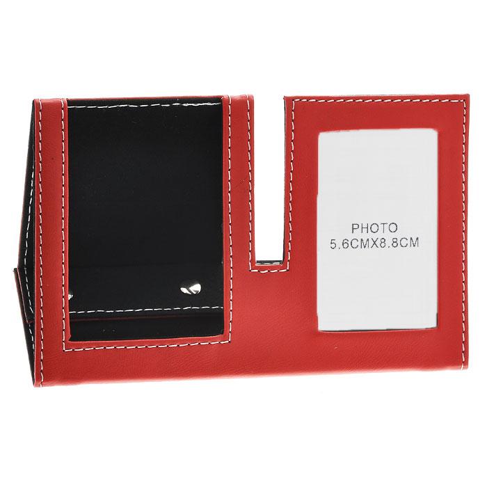 Подставка для мобильного телефона с рамкой для фото, цвет: красный, 5,5 см х 8,5 см. 2882928829Оригинальная подставка для мобильного телефона выполнена из картона с отделкой из ПВХ, стилизованной под кожу красного цвета. Внутренняя поверхность отделана бархатистым материалом. Подставка оформлена фоторамкой, в которую вы можете поместить фотографию любимого человека или счастливого события своей жизни. Благодаря эксклюзивному дизайну, подставка оформит ваш рабочий стол, а также станет практичным сувениром для друзей и коллег. Характеристики: Материал: картон, ПВХ, металл. Размер подставки: 19 см х 7 см х 8,5 см. Размер фоторамки: 8,3 см х 11,5 см. Размер фотографии: 5,5 см х 8,5 см. Размер упаковки: 19,5 см х 12,5 см х 1,5 см. Артикул: 28829.