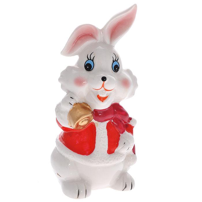 Декоративная копилка Кролик. 2064120641Декоративная копилка Кролик выполнена из керамики в виде белого кролика с колокольчиком. Для удобного извлечения денег в копилке имеется резиновая крышка с отверстием. Копилка послужит приятным и полезным сувениром для близких и знакомых и, несомненно, доставит массу положительных эмоций своему обладателю.