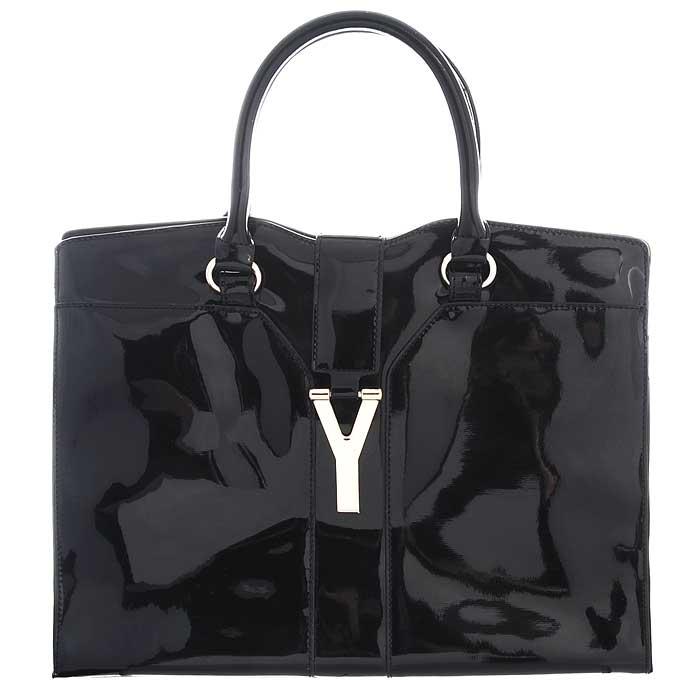 Сумка женская Fancy bag , цвет: черный. 131-1-04131-1-04 чернСтильная сумка Fancy Bag выполнена из искусственной лаковой кожи черного цвета. Сумка закрывается на застежку-молнию и сверху узким декоративным клапаном. Имеет одно отделение, содержащее внутри карман на застежке-молнии и два накладных открытых кармашка. Сумка оснащена двумя ручками, крепящимися при помощи металлических колец. В комплекте чехол для хранения. Этот стильный аксессуар станет изысканным дополнением к вашему образу. Характеристики: Цвет: черный. Материал: экокожа, металл, текстиль. Размер сумки: 37 см х 27,5 см х 17 см. Высота ручек: 17 см. Артикул: 131-1-04.