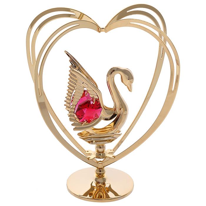 Фигурка декоративная Лебедь, цвет: золотистый67535Декоративная фигурка Лебедь, золотистого цвета, станет необычным аксессуаром для вашего интерьера и создаст незабываемую атмосферу. Фигурка выполнена в виде лебедя, размещенного в центре сердца, и декорирована красными кристаллами. Кристаллы, украшающие фигурку, носят громкое имя Swarovski. Ограненные, как бриллианты, кристаллы блистают сотнями тысяч различных оттенков. Эта очаровательная вещь послужит отличным подарком близкому человеку, родственнику или другу, а также подарит приятные мгновения и окунет вас в лучшие воспоминания. Фигурка упакована в подарочную коробку.