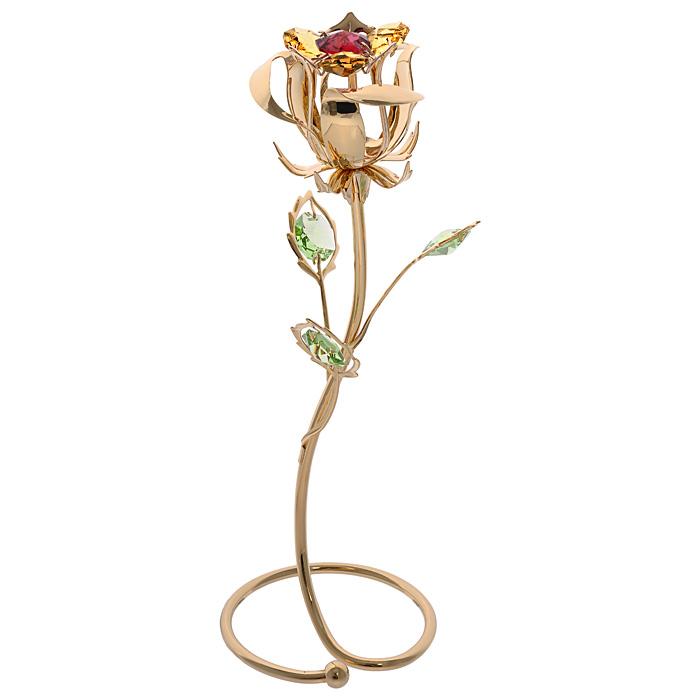 Фигурка декоративная Роза, цвет: золотистый. 6757567575Декоративная фигурка Роза, золотистого цвета, станет необычным аксессуаром для вашего интерьера и создаст незабываемую атмосферу. Фигурка выполнена в виде цветка розы на подставке и инкрустирована разноцветными кристаллами. Кристаллы, украшающие фигурку, носят громкое имя Swarovski. Ограненные, как бриллианты, кристаллы блистают сотнями тысяч различных оттенков. Эта очаровательная фигурка послужит отличным функциональным подарком, а также подарит приятные мгновения и окунет вас в лучшие воспоминания. Фигурка упакована в подарочную коробку. Характеристики: Материал: металл (углеродистая сталь, покрытие золотом 0,05 микрон), австрийские кристаллы. Размер фигурки: 6,5 см х 18,5 см х 6,5 см. Цвет: золотистый. Размер упаковки: 13,5 см х 23,5 см х 9,5 см. Артикул: 67575. Более чем 30 лет назад компания Crystocraft выросла из ведущего производителя в перспективную торговую марку, которая задает тенденцию благодаря безупречному...