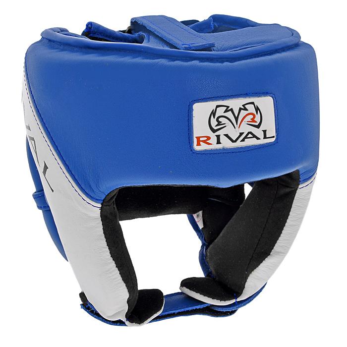 Шлем боксерский Rival, тренировочный, цвет: синий. Размер МRHGС1Тренировочный боксерский шлем Rival синего цвета с белой отделкой предназначен для предохранения головы от жестких ударов, травмирования бровей, ушей и лица. Внешняя поверхность шлема выполнена из натуральной кожи, внутренняя поверхность - из замши. Благодаря двойному пенному наполнителю, шлем обеспечивает защиту в области лба, ушей и скул, а также создает дополнительный комфорт за счет анатомической подушки в тыльной части. Шлем регулируется по ширине в верхней части и прочно фиксируется на голове при помощи застежек на липучке Velcro. На подбородке шлем застегивается на прочную застежку на липучке. Такой шлем погасит силу ударов и надежно защитит все зоны головы от повреждений.
