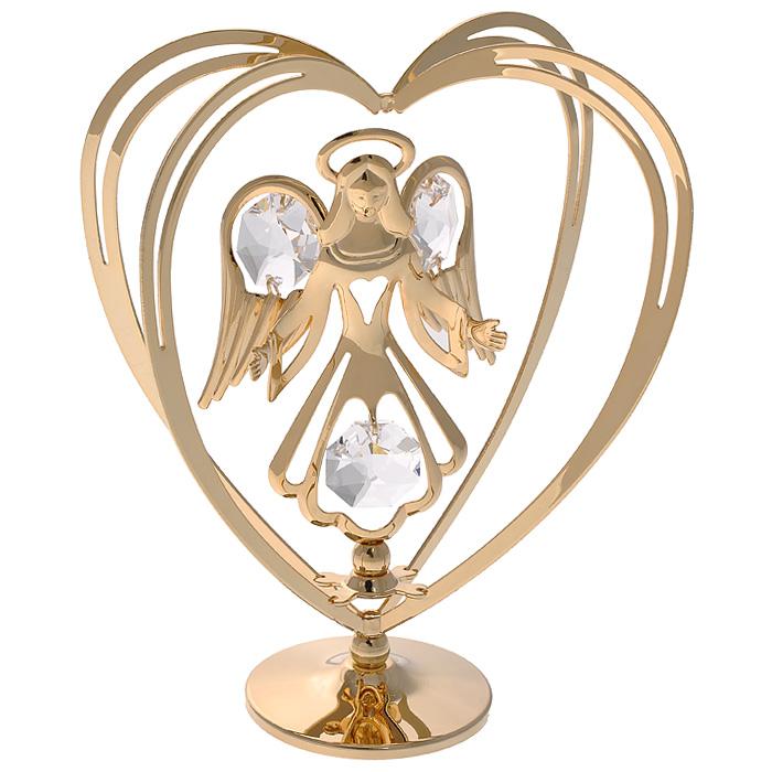 Фигурка декоративная Ангел, цвет: золотистый. 6711867118Декоративная фигурка Ангел, золотистого цвета, станет необычным аксессуаром для вашего интерьера и создаст незабываемую атмосферу. Фигурка выполнена в виде ангела с распростертыми руками, стоящего внутри сердца, и инкрустирована белыми кристаллами. Кристаллы, украшающие фигурку, носят громкое имя Swarovski. Ограненные, как бриллианты, кристаллы блистают сотнями тысяч различных оттенков. Эта очаровательная вещь послужит отличным подарком близкому человеку, родственнику или другу, а также подарит приятные мгновения и окунет вас в лучшие воспоминания. Фигурка упакована в подарочную коробку.