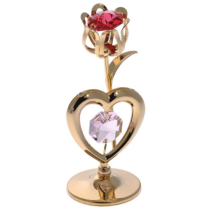 Фигурка декоративная Тюльпан, цвет: золотистый. 6700767007Декоративная фигурка Тюльпан, золотистого цвета, станет необычным аксессуаром для вашего интерьера и создаст незабываемую атмосферу. Фигурка выполнена в виде тюльпана с сердечком на подставке и инкрустирована красным и розовым кристаллами. Кристаллы, украшающие фигурку, носят громкое имя Swarovski. Ограненные, как бриллианты, кристаллы блистают сотнями тысяч различных оттенков. Эта очаровательная фигурка послужит отличным функциональным подарком, а также подарит приятные мгновения и окунет вас в лучшие воспоминания. Фигурка упакована в подарочную коробку.